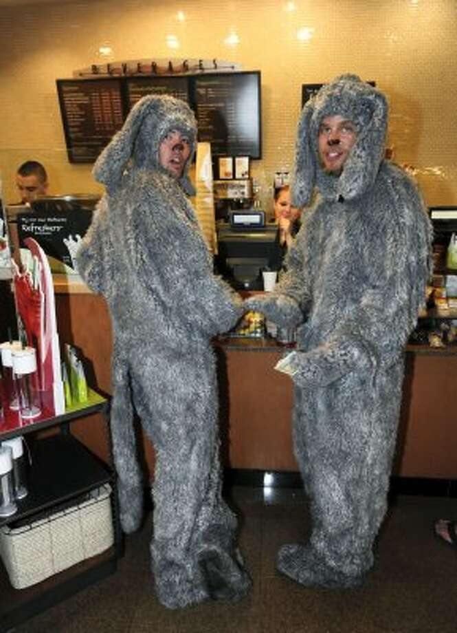 Ian Moore, left, and Steve Mara dressed as the television character Wilfred order coffee at Starbucks near the Comic-Con convention held at the San Diego Convention Center on Thursday July 12, 2012, in San Diego.  (Photo by Denis Poroy/Invision/AP) (DENIS POROY/INVISION/AP)