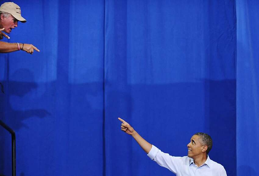 US President Barack Obama greets a supporter as he arrives to speak at a campaign event July 13, 2012 at Phoebus High School in Hampton, Virginia. AFP PHOTO/Mandel NGANMANDEL NGAN/AFP/GettyImages