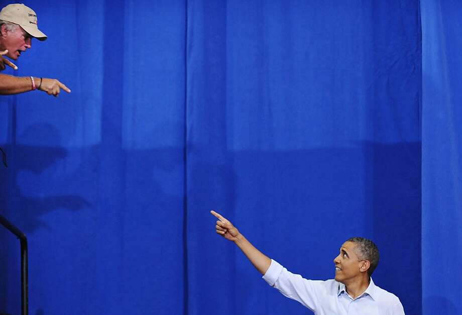US President Barack Obama greets a supporter as he arrives to speak at a campaign event July 13, 2012 at Phoebus High School in Hampton, Virginia. AFP PHOTO/Mandel NGANMANDEL NGAN/AFP/GettyImages Photo: Mandel Ngan, AFP/Getty Images