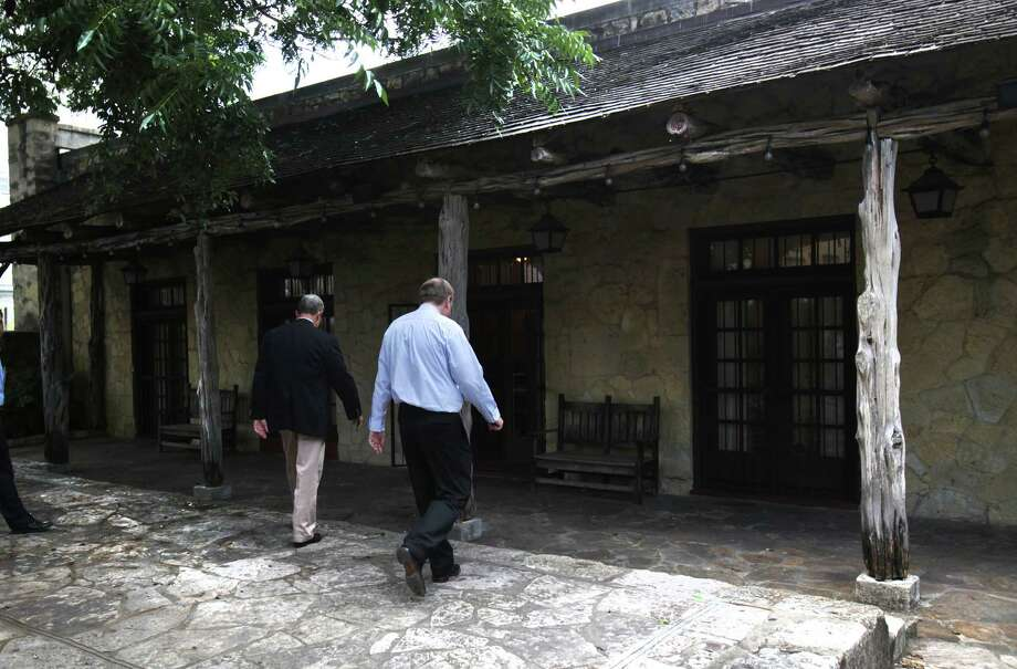 Jerry Patterson, Texas Land Commissioner, left, and Stephen Oswald, the Director of the Alamo, walk to the Alamo Hall, built in 1922 which was an old city fire station. Private functions held at the building will have the option of serving alcohol. Friday, July 13, 2012. Photo: BOB OWEN, San Antonio Express-News / © 2012 San Antonio Express-News