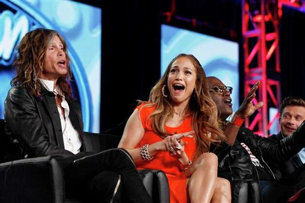 "FILE - In this Jan. 8, 2012 photo, ""American Idol"" judge Jennifer Lopez, center, reacts as fellow judge Steven Tyler, left, of Aerosmith makes a joke about wearing Lopez's pants as Randy Jackson and Ryan Seacrest are seen at right during the ""American Idol"" panel at the Fox Broadcasting Company Television Critics Association Winter Press Tour in Pasadena, Calif. ""American Idol"" is on the brink of a crisis, Thursday, July 12, 2012, as judge Steven Tyler is leaving, and fellow judge Jennifer Lopez is dithering about staying put. Photo: Danny Moloshok, AP / AP2012"
