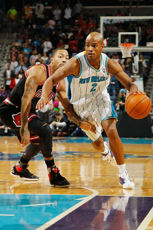 NEW ORLEANS, LA - FEBRUARY 08:  Jarrett Jack #2 of the New Orleans Hornets drives the ball around Derrick Rose #1 of the Chicago Bulls at New Orleans Arena on February 8, 2012 in New Orleans, Louisiana.  NOTE TO USER: User expressly acknowledges and agrees that, by downloading and or using this photograph, User is consenting to the terms and conditions of the Getty Images License Agreement.  (Photo by Chris Graythen/Getty Images) Photo: Chris Graythen, Getty Images