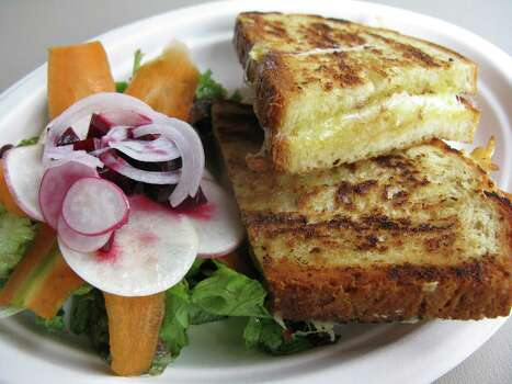 Grilled cheese sandwich and salad from Restaurant Gwendolyn's new lunch menu. www.restaurantgwendolyn.com Photo: Jennifer McInnis / Jmcinnis@express-news.net