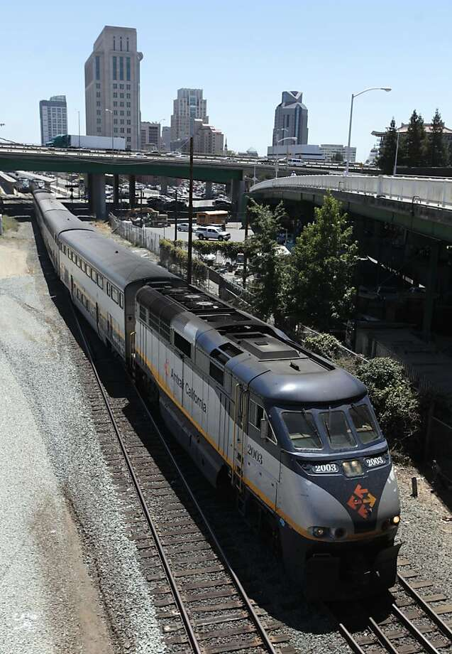 An Amtrak train bound for the San Francisco Bay area leaves the station in Sacramento, Calif., Thursday, July 5. 2012.  By a 51-27 vote on Thursday, the state Assembly approved a bill authorizing the state to begin selling $4.5 billion in voter -approved bonds for a high-speed rail system. When completed the high-speed rail system would link trains traveling up to 220 mph to Amtrak and other existing passenger rail lines. (AP Photo/Rich Pedroncelli) Photo: Rich Pedroncelli, Associated Press