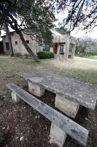 The teacher and students used to eat lunch at cement tables in the front yard of the school. (Danny Warner)