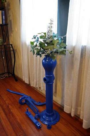 Part of the pump from the school's well is being used as a plant stand until it can be put back into service outside (Danny Warner)