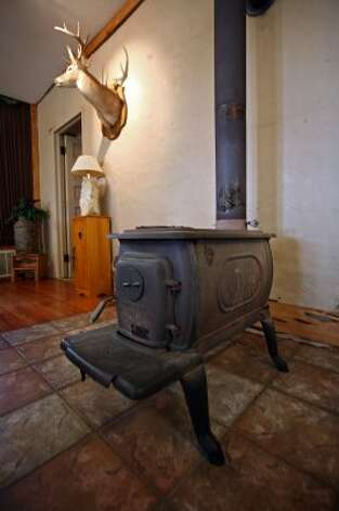 The original wood-burning stove for the school was no longer in the building, so the Schotts bought a similar one to heat their home. (Danny Warner)