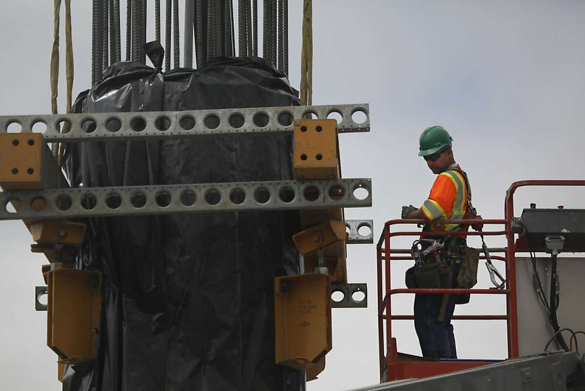 Bill Kirby of San Leandro works at the Oakland Airport Connector project site on Hegenberger Road on Friday, July 13, 2012 in Oakland, Calif.