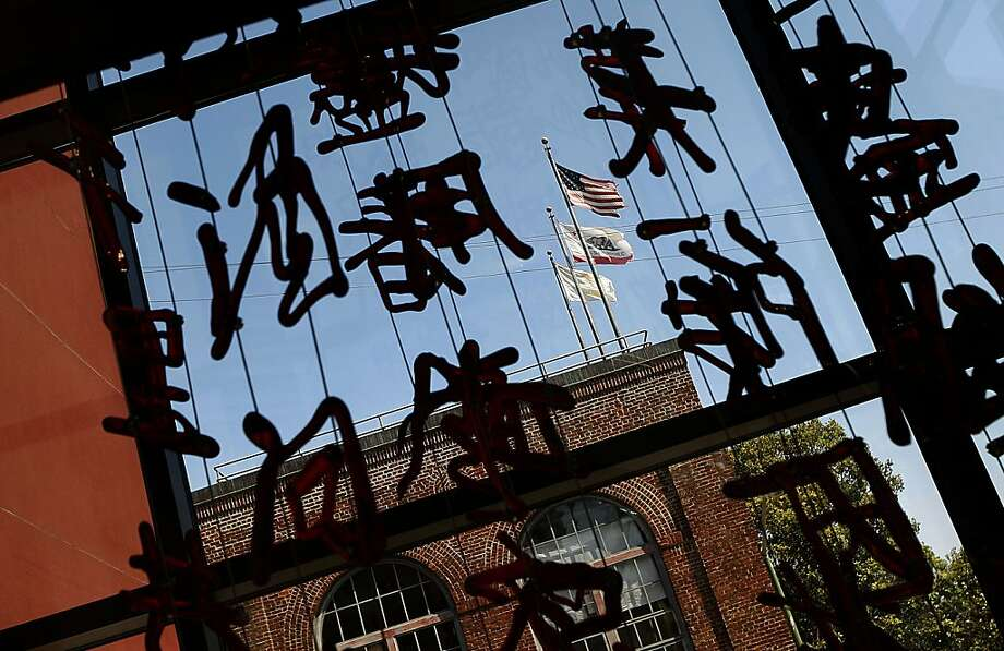 Blown glass characters in venetian handmade glass suspended in poems by Bai Juyi (772-846)and Su Shi (1036-1101) as well as by installation artist Shan Shan Sheng at the newly constructed Chinese Center in San Francisco, Calif., on Thursday,  July 12, 2012. Photo: Liz Hafalia, The Chronicle