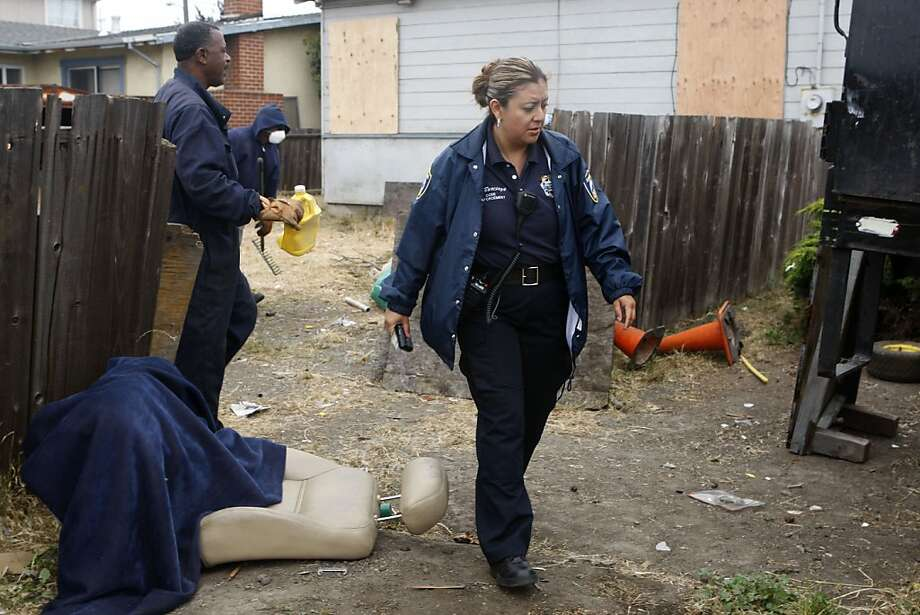 Richmond code enforcement officer Lorena Burciaga looking at a lot being cleared next to a foreclosed home on 360 South 6th Street in Richmond, Calif.,  on Friday,  July 13, 2012. Photo: Liz Hafalia, The Chronicle