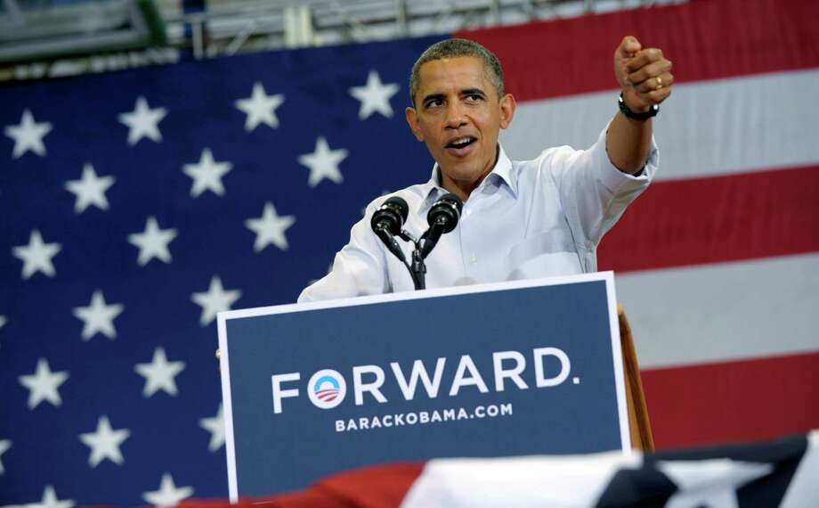 President Barack Obama speaks at a campaign event at Green Run High School in Virginia Beach, Va., Friday, July 13, 2012. Obama is spending the day in Virginia campaigning. (AP Photo/Susan Walsh) Photo: Susan Walsh