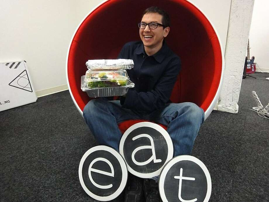 Arram Sabeti founded ZeroCater, which serves up food to 220 companies. Here he is in the company's office at 875 Sansome St. in San Francisco Photo: ZeroCater