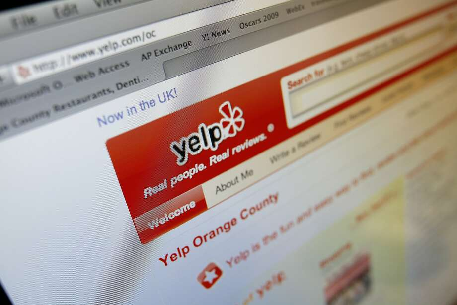 The Yelp Web site is shown on a computer screen in Los Angeles. Yelp now letting visitors see those that are automatically filtered out by software meant to catch content that isn't trustworthy. Photo: Richard Vogel, AP