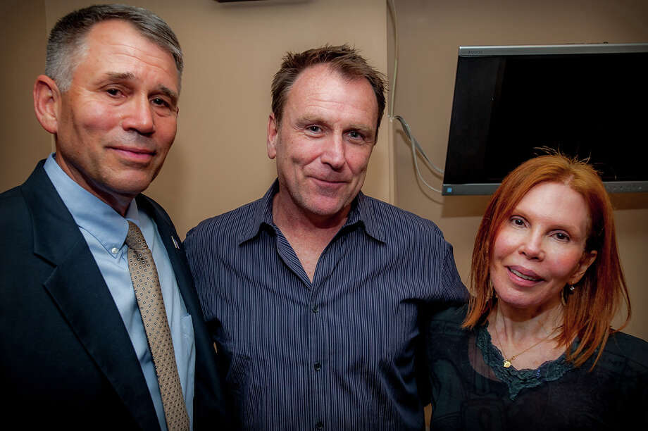 From left, Maj. Gen. John Batiste, comedian Colin Quinn and Eilhys England Hackworth at Stand for the Troops' evening of comedy at Gotham Comedy Club in New York. Photo: Contributed Photo / Greenwich Time Contributed