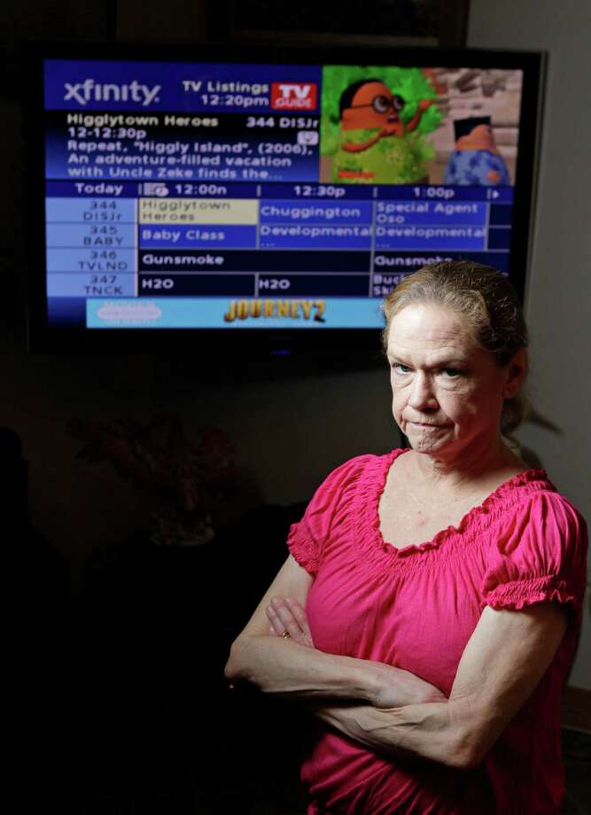 Doreen Whitmer knew her previous cable box had been replaced with a DVR by Comcast. She didn't know that her old equipment was stolen and used to get cable on her account. Photo: Melissa Phillip / © 2012 Houston Chronicle