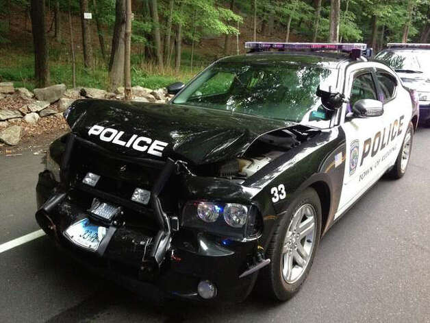 Two Redding police cruisers were damaged Friday evening after police said a man evading an accident in Weston on Route 53 backed into one cruiser and then punched the side window of a second. He was Tasered before he was taken into custody. Photo: Contributed