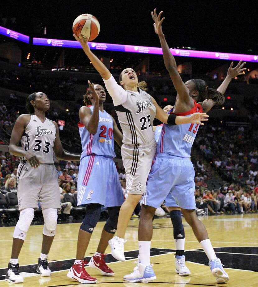 Silver Stars' Becky Hammon shoots between Dream's Sancho Lyttle and Dream's Aneika Henry as teammate Stars' Sophia Young looks on during second half action Friday, July 13, 2012 at the AT&T Center. The Stars won 91-70. Photo: Edward A. Ornelas, Express-News / © 2012 San Antonio Express-News