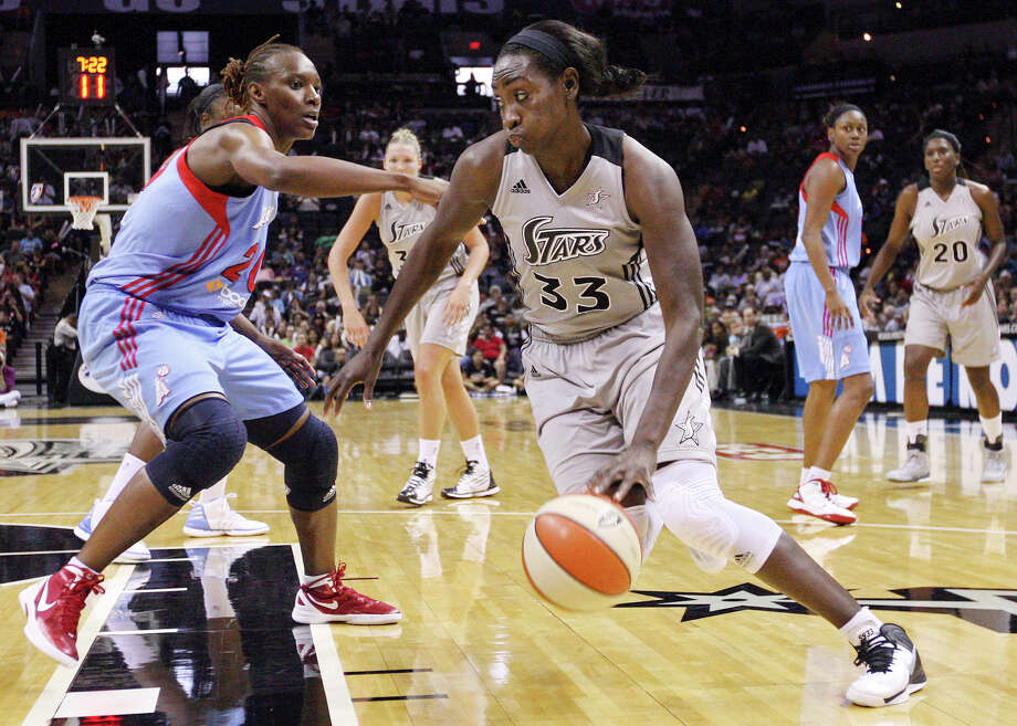 Silver Stars' Sophia Young looks for room around the Dream's Sancho Lyttle during second half action Friday, July 13, 2012 at the AT&T Center. The Stars won 91-70. Photo: Edward A. Ornelas, Express-News / © 2012 San Antonio Express-News