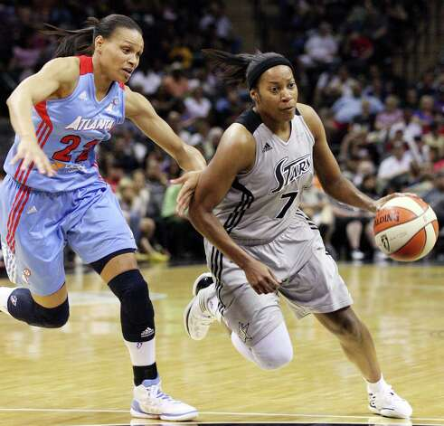 Silver Stars' Jia Perkins drives around the Dream's Armintie Price during second half action Friday, July 13, 2012 at the AT&T Center. The Stars won 91-70. Photo: Edward A. Ornelas, Express-News / © 2012 San Antonio Express-News