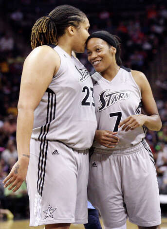 Silver Stars' Danielle Adams (left) celebrates with teammate Stars' Jia Perkins after Perkins made a 3-pointer against the Dream during second half action Friday, July 13, 2012 at the AT&T Center. The Stars won 91-70. Photo: Edward A. Ornelas, Express-News / © 2012 San Antonio Express-News