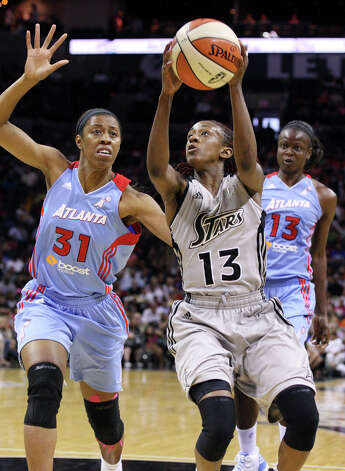 Silver Stars' Danielle Robinson looks for room around Dream's Jessica Moore during second half action Friday, July 13, 2012 at the AT&T Center. The Stars won 91-70. Photo: Edward A. Ornelas, Express-News / © 2012 San Antonio Express-News
