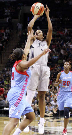 Silver Stars' Jia Perkins shoots over Dream's Ketia Swanier during second half action Friday, July 13, 2012 at the AT&T Center. The Stars won 91-70. Photo: Edward A. Ornelas, Express-News / © 2012 San Antonio Express-News