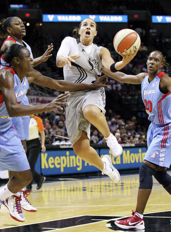Silver Stars' Becky Hammon is fouled by Dream's Aneika Henry (left) as she drives to the basket during first half action Friday, July 13, 2012 at the AT&T Center. Photo: Edward A. Ornelas, Express-News / © 2012 San Antonio Express-News