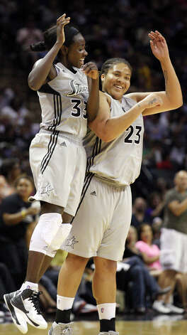 Silver Stars' Sophia Young (left) celebrates with teammate Stars' Danielle Adams after a score during second half action against the Dream Friday, July 13, 2012 at the AT&T Center. The Stars won 91-70. Photo: Edward A. Ornelas, Express-News / © 2012 San Antonio Express-News