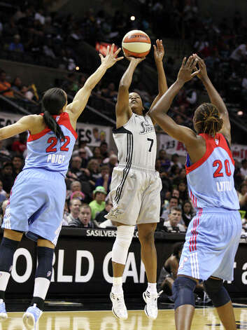 Silver Stars' Jia Perkins shoots between Dream's Armintie Price and Dream's Sancho Lyttle  during first half action Friday, July 13, 2012 at the AT&T Center. Photo: Edward A. Ornelas, Express-News / © 2012 San Antonio Express-News