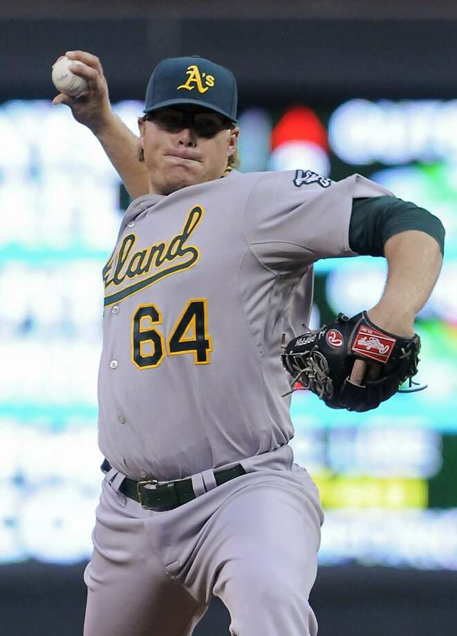 Oakland Athletics pitcher A.J. Griffin throws against the Minnesota Twins in the first inning of a baseball game Friday, July 13, 2012, in Minneapolis. (AP Photo/Jim Mone) Photo: Jim Mone, Associated Press
