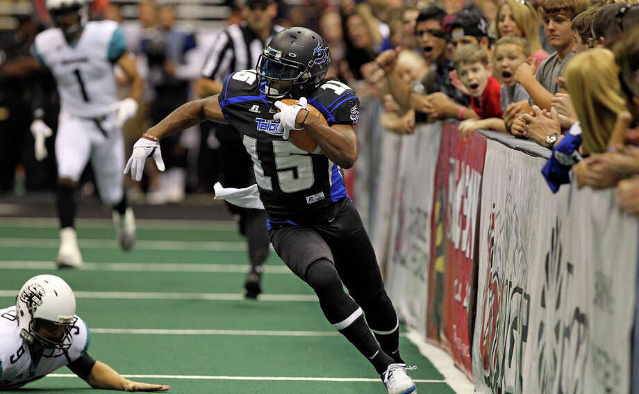 Talons receiver Jomo Wilson breaks to the open along the sideline for a first quarter kickoff return touchdown as the Talons host the Arizona Rattlers at the Alamodome  on July 13, 2012. Photo: Tom Reel, Express-News / ©2012 San Antono Express-News