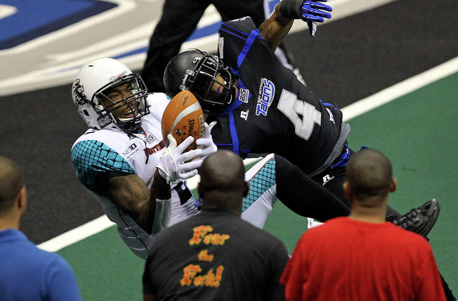 Arizona receiver Maurice Purify hauls in a pass at the goal line over Talons defender Kenneth Fontenette which is first called a touchdown, but then over ruled after a protest.  The Rattlers scored however scored on the next possession as the Talons dueled the Arizona Rattlers at the Alamodome  on July 13, 2012. Photo: Tom Reel, Express-News / ©2012 San Antono Express-News