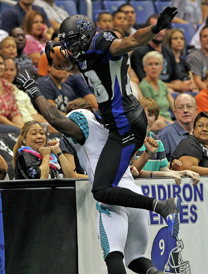 Talons wide receiver Derek Lee gets over the back of a defender to stay in bounds on a catch as the Talons host the Arizona Rattlers at the Alamodome  on July 13, 2012. Photo: Tom Reel, Express-News / ©2012 San Antono Express-News