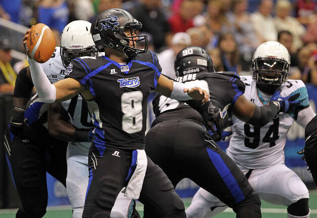 Aaron Garcia picks a receiver in the first half as the Talons host the Arizona Rattlers at the Alamodome  on July 13, 2012. Photo: Tom Reel, Express-News / ©2012 San Antono Express-News