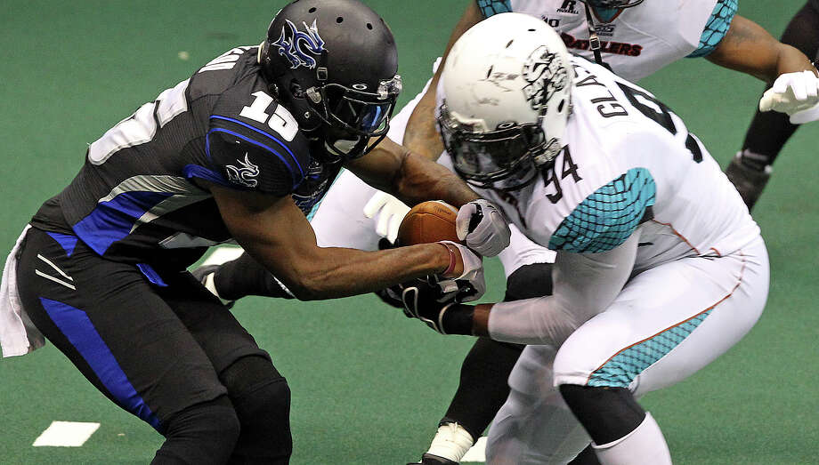 The Talons Jomo Wilson can't get control of a loose kickoff ball which had bounced off the goal standard into Tyre Glasper who eventually pounces on the ball with teammates to allow a quick score near the end of the first half as the Talons host the Arizona Rattlers at the Alamodome  on July 13, 2012. Photo: Tom Reel, Express-News / ©2012 San Antono Express-News