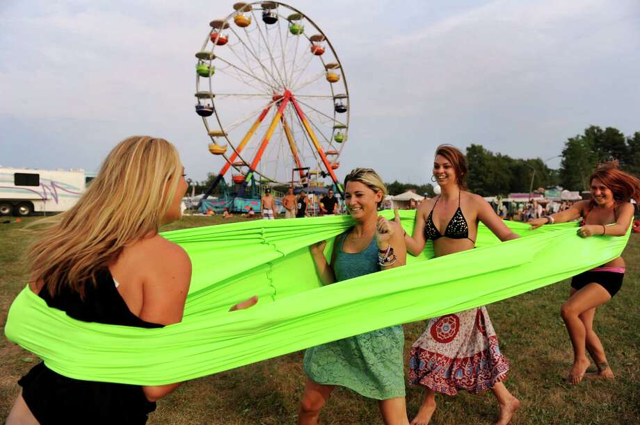 Concert goers bounce off the sides of a Human Rubberband at Camp Bisco on Friday, July 13, 2012, at Indian Lookout Country Club in Mariaville, N.Y. From left are Jenna Taylor, 21, of Rochester, Somer Hackler, 22, of Syracuse, Becky Wesley, 21, of Glenville and Sam Errico, 20, of Rotterdam. (Cindy Schultz / Times Union) Photo: Cindy Schultz / 00018447A