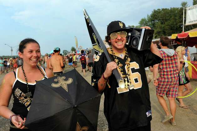 Kari Russo, 25, left, and Tom Anderson, 25, both of Pittsburgh, show their Steelers pride at Camp Bisco on Friday, July 13, 2012, at Indian Lookout Country Club in Mariaville, N.Y. (Cindy Schultz / Times Union) Photo: Cindy Schultz / 00018447A