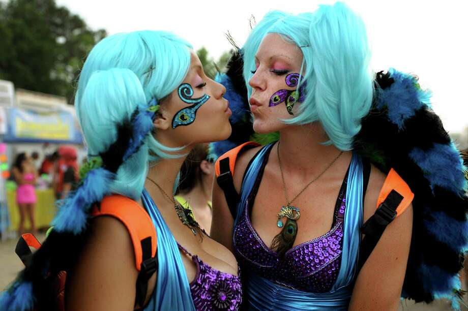 Bree Land, 19, of Detroit, left, and Amber Underwood, 24, of Hamilton, Mich. strike a pose at Camp Bisco on Friday, July 13, 2012, at Indian Lookout Country Club in Mariaville, N.Y. They are members of Glam Dolls, a group of performing artists who dance on stage during electronic music shows. (Cindy Schultz / Times Union) Photo: Cindy Schultz / 00018447A