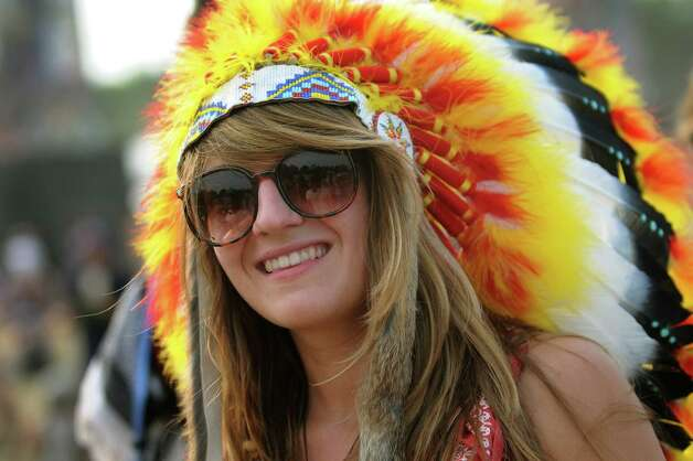 Keeley Breuer, 22, of New Haven, Conn. wears a colorful headdress at Camp Bisco on Friday, July 13, 2012, at Indian Lookout Country Club in Mariaville, N.Y. (Cindy Schultz / Times Union) Photo: Cindy Schultz / 00018447A