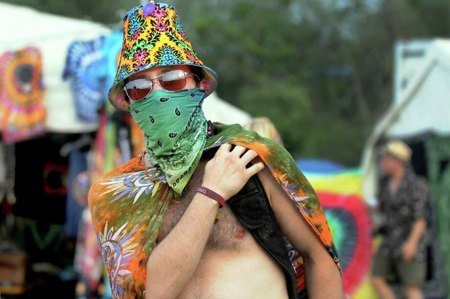 Gordon McPherson, 27, of Wappingers Falls wears a colorful lampshade as a hat and a bandana to fend off the dust at Camp Bisco on Friday, July 13, 2012, at Indian Lookout Country Club in Mariaville, N.Y. (Cindy Schultz / Times Union) Photo: Cindy Schultz / 00018447A