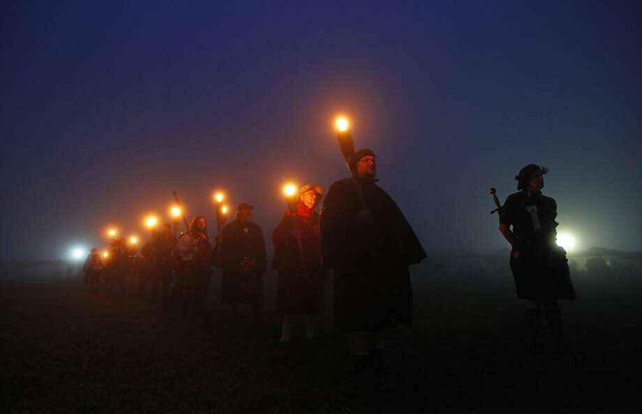Members of different Scottish clans stand in the fog during the opening ceremony of the Grandfather Mountain Highland Games in Linville, N.C., Thursday, July 12, 2012. (AP Photo/Chuck Burton) Photo: Chuck Burton, Associated Press