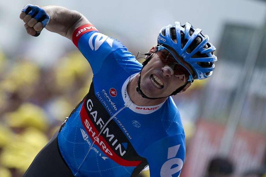 Stage winner,Great Britain's David Millar, celebrates as he crosses the finish line at the end of the 226 km and twelfth stage of the 2012 Tour de France cycling race starting in Saint-Jean-de-Maurienne and finishing in Annonay Davezieux, southeastern France, on July 13, 2012.    AFP PHOTO / LIONEL BONAVENTURELIONEL BONAVENTURE/AFP/GettyImages Photo: Lionel Bonaventure, AFP/Getty Images