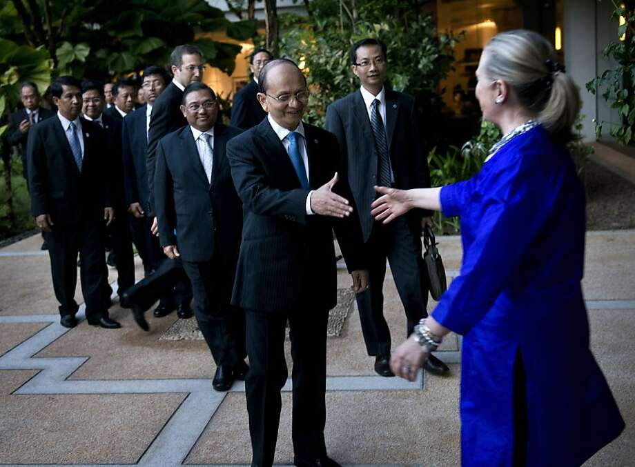 U.S. Secretary of State Hillary Rodham Clinton, right, greets Myanmar Preside Thein Sein before a meeting at Le Meridien Hotel Friday, July 13, 2012 in Siem Reap, Cambodia. Clinton is in Cambodia to attend ASEAN regional forum and meet with other ministers and leaders to strengthen economic and strategic relationships between Asia and the U.S. (AP Photo/Brendan Smialowski, Pool) Photo: Brendan Smialowski, Associated Press