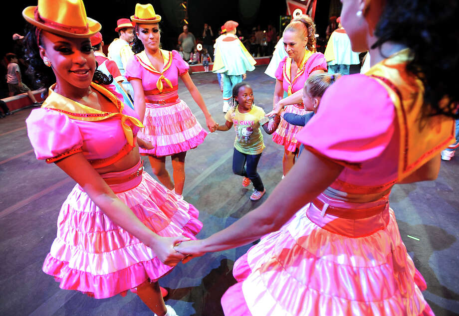 Children dance with the performers in the ring during the preshow festivities of the Ringling Bros. and Barnum & Bailey Circus at Ford Park in Beaumont, Friday, July 13, 2012. Tammy McKinley/The Enterprise Photo: TAMMY MCKINLEY