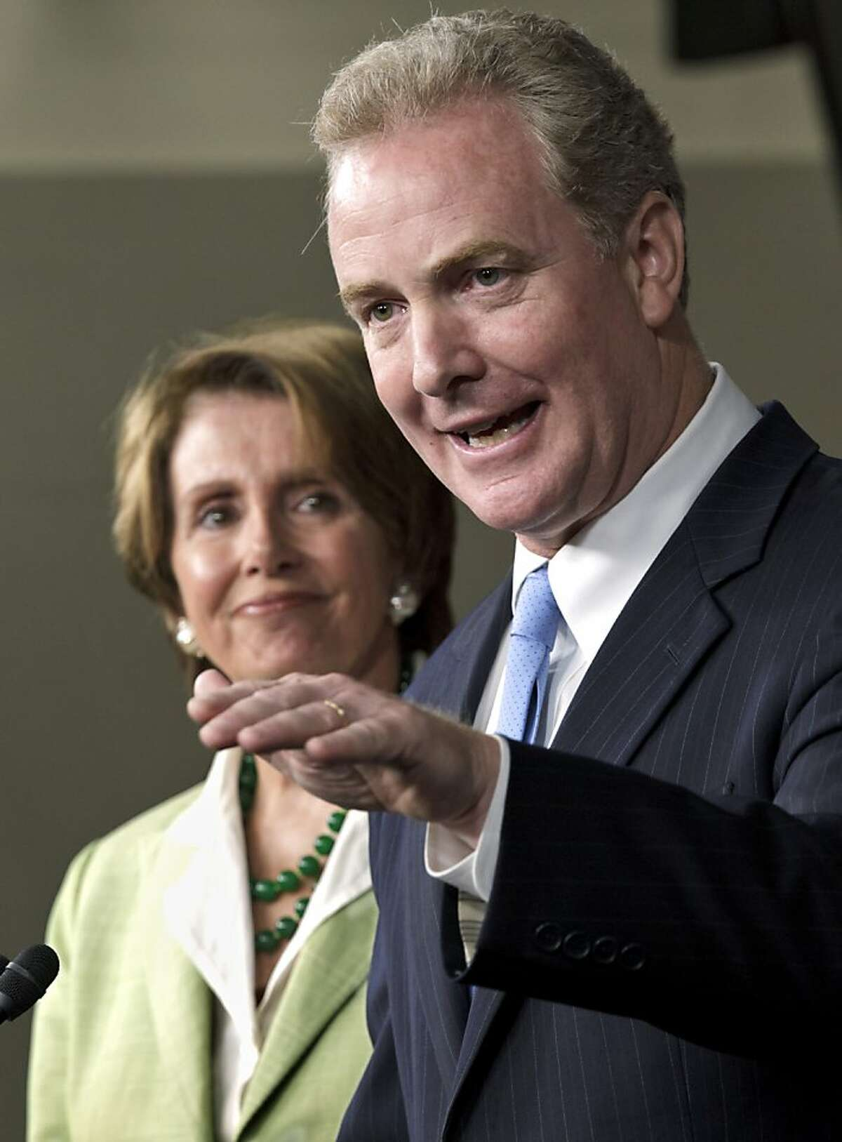 House Minority Leader Nancy Pelosi of Calif. listens a left as Rep. Chris Van Hollen, D-Md. speaks during a news conference on Capitol Hill in Washington, Thursday, July 12, 2012. (AP Photo/J. Scott Applewhite)