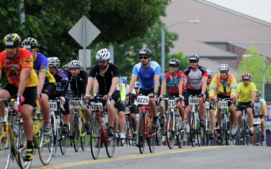 Riders bike on Montlake Boulevard Northeast from the University of Washington at the start of the 33rd Group Health Seattle to Portland Bicycle Classic on Saturday, July 14, 2012. Approximately 10,000 riders from  at least 40 states will attempt to ride 202 miles to reach Portland, most of them getting there on Sunday. Photo: LINDSEY WASSON / SEATTLEPI.COM