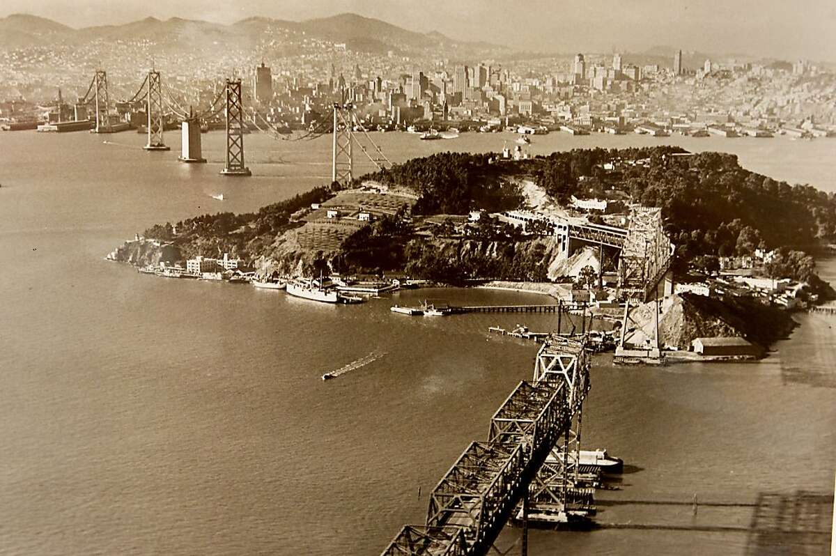 A photograph taken in November of 1935 showing the Bay Bridge construction and San Francisco in the background. Historians at the Bancroft Library at UC Berkeley are looking for Bay Bridge enthusiasts, toll takers, and engineers to share their stories about the early days of the span for an oral history project. ALL BRIDGE PHOTOGRAPHS COURTESY OF THE BANCROFT LIBRARY, UNIVERSITY OF CALIFORNIA, BERKELEY. ONE TIME PRINT USAGE ONLY