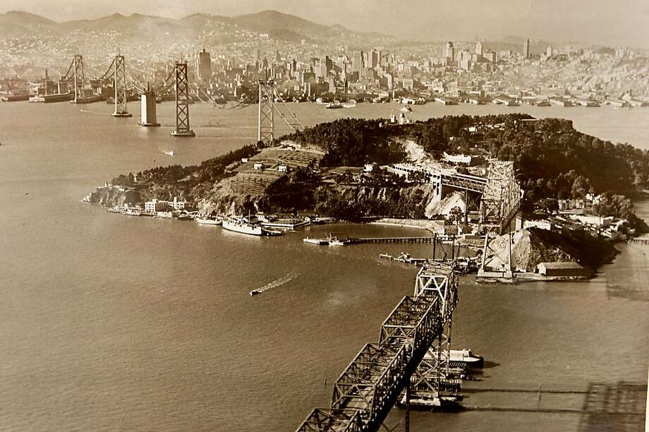 A photograph taken in November of 1935 showing the Bay Bridge construction and San Francisco in the background. Historians at the Bancroft Library at UC Berkeley are looking for Bay Bridge enthusiasts, toll takers, and engineers to share their stories about the early days of the span for an oral history project. ALL BRIDGE PHOTOGRAPHS COURTESY OF THE BANCROFT LIBRARY, UNIVERSITY OF CALIFORNIA, BERKELEY.   ONE TIME PRINT USAGE ONLY Photo: Brant Ward, The Chronicle
