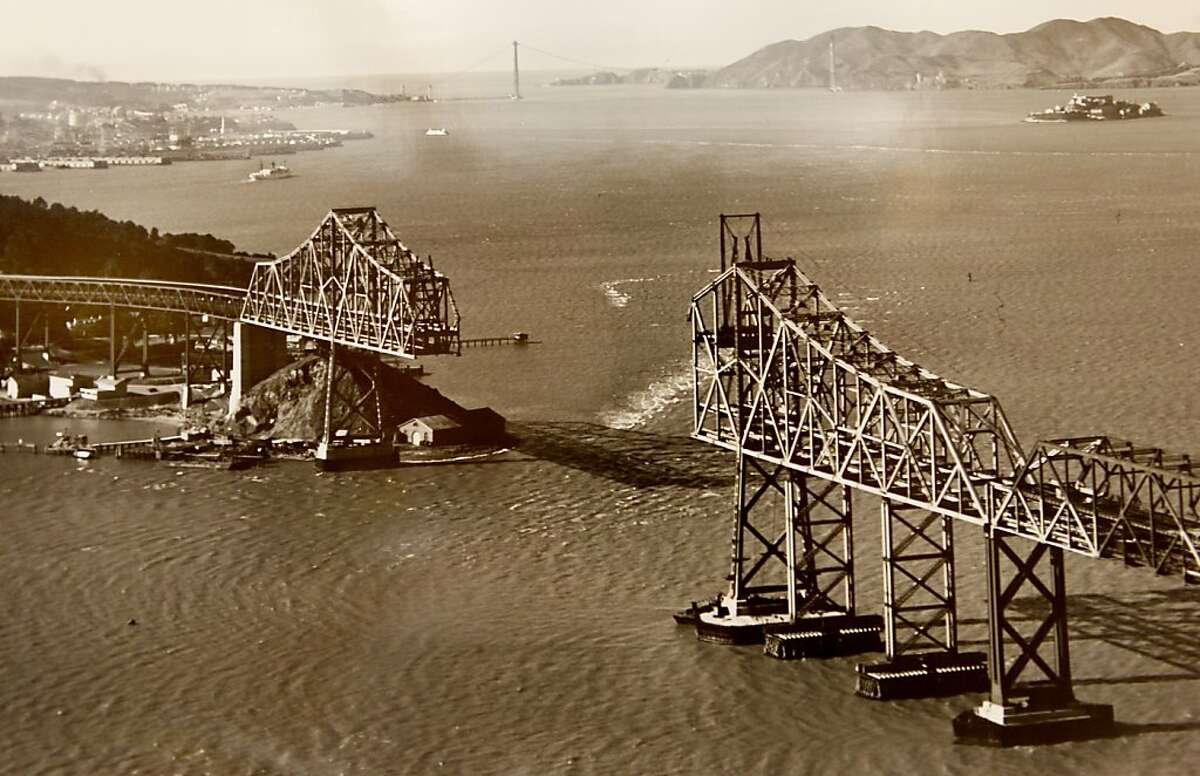 A 1936 photograph of the cantilever portion of the Bay Bridge with the Golden Gate Bridge in background. Historians at the Bancroft Library at UC Berkeley are looking for Bay Bridge enthusiasts, toll takers, and engineers to share their stories about the early days of the span for an oral history project. ALL BRIDGE PHOTOGRAPHS COURTESY OF THE BANCROFT LIBRARY, UNIVERSITY OF CALIFORNIA, BERKELEY. ONE TIME PRINT USAGE ONLY
