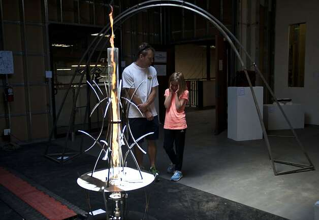 Michael Schulte, left, and his daughter Esme Schulte check fire performance at The Crucible on Saturday, July 14, 2012 in Oakland, Calif. Photo: Yue Wu, The Chronicle